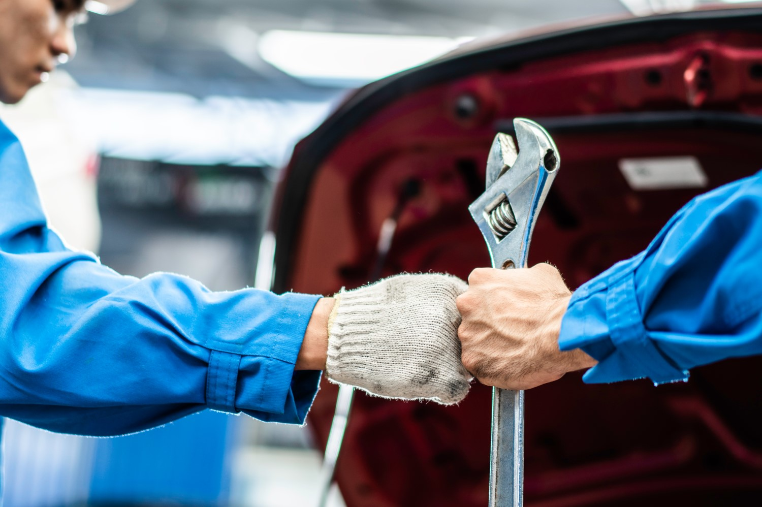 stock-photo-auto-mechanic-man-holding-wrench-bumping-fists-with-team-colleague-worker-in-auto-repair-shop-1730149930