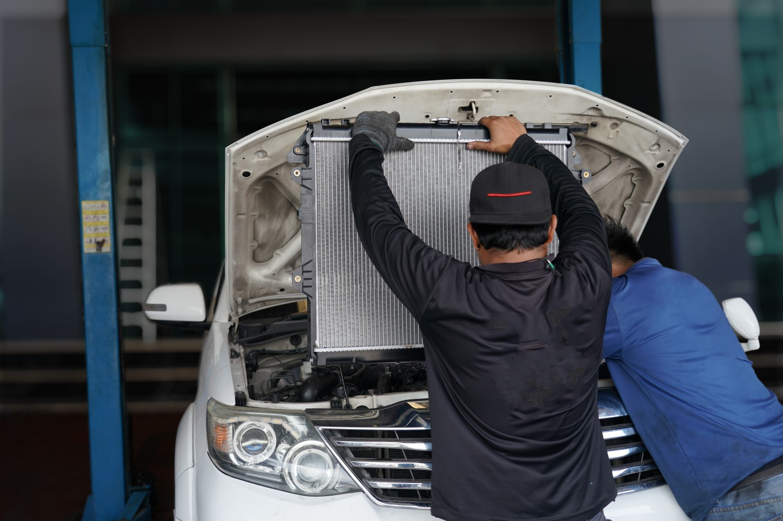 stock-photo-car-aluminum-radiator-cooling-panel-unpacking-new-for-car-maintenance-service-1980389651-min