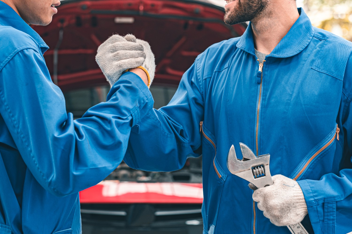 stock-photo-car-mechanic-ready-for-work-auto-mechanic-with-large-wrench-in-hands-ideas-how-to-fix-the-problem-1843975420-min
