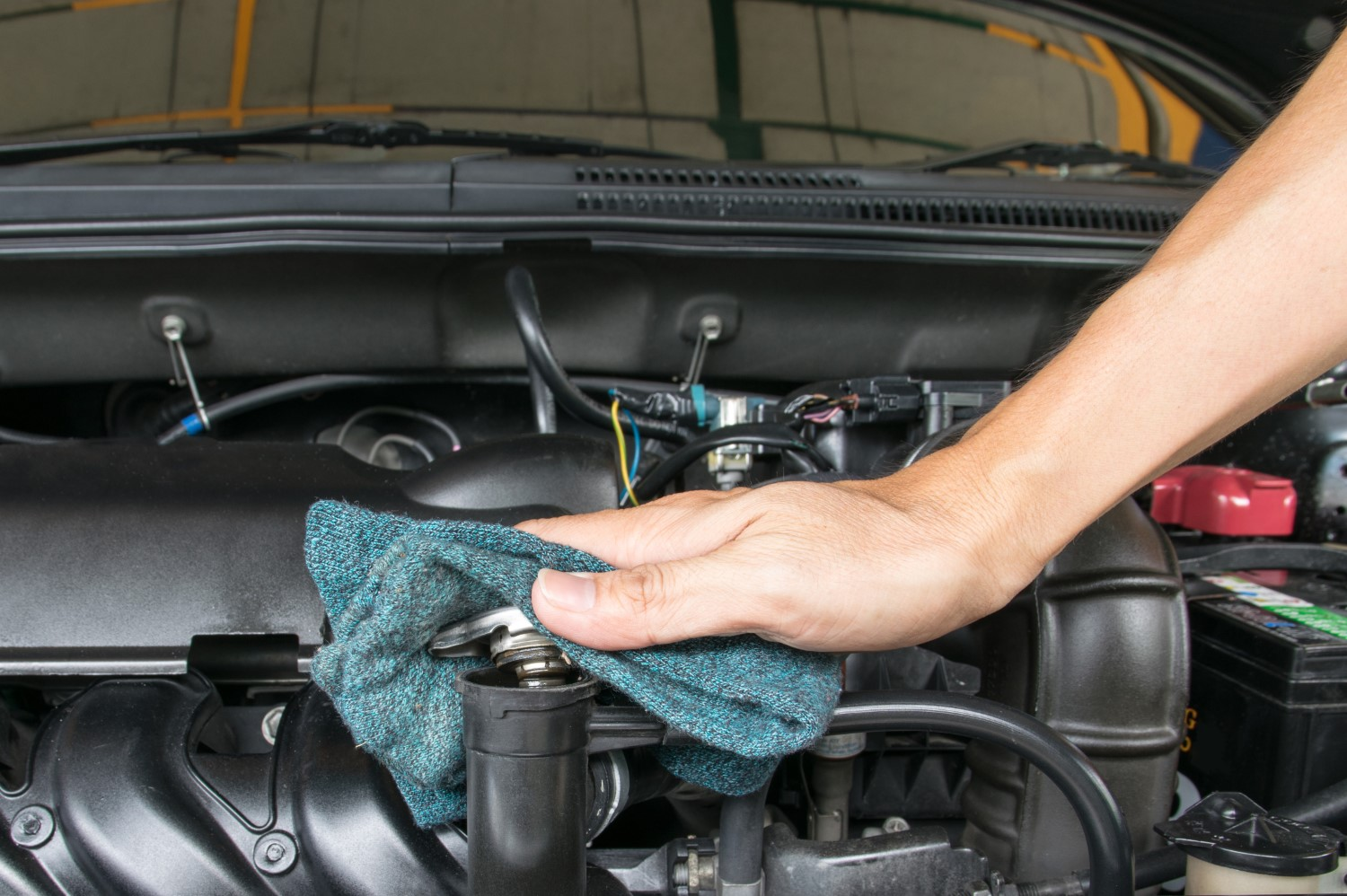 stock-photo-hand-open-valve-metal-cover-on-an-radiator-for-engine-cooling-287533067-min