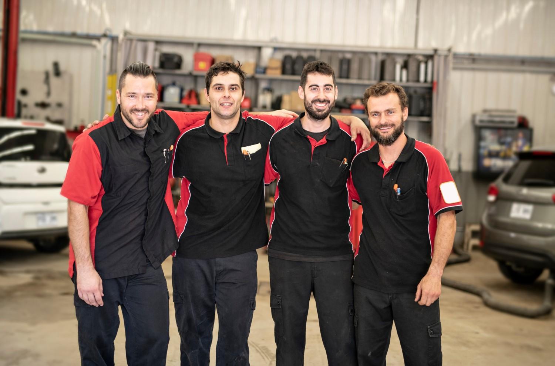 stock-photo-portrait-of-auto-shop-mechanics-group-together-employee-1189039066-min