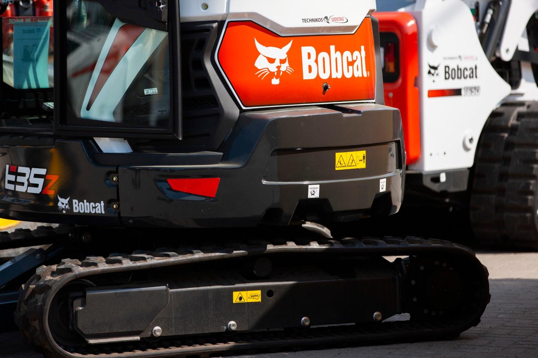 stock-photo-vilnius-lithuania-april-bobcat-heavy-duty-equipment-vehicle-and-logo-bobcat-company-is-an-1384721378-min